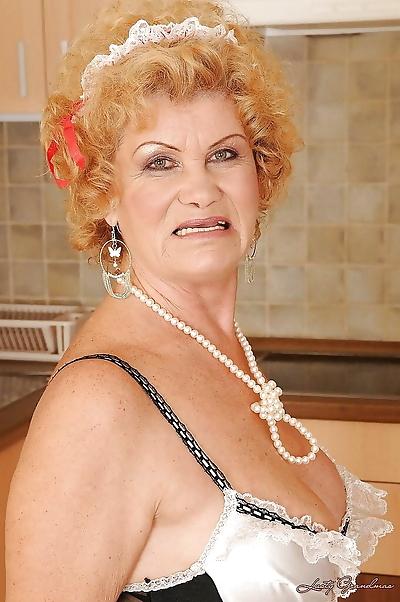 Lusty granny in maid uniform..
