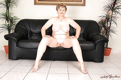 Busty granny on high heels..