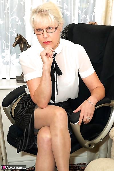 Slender mature secretary in..