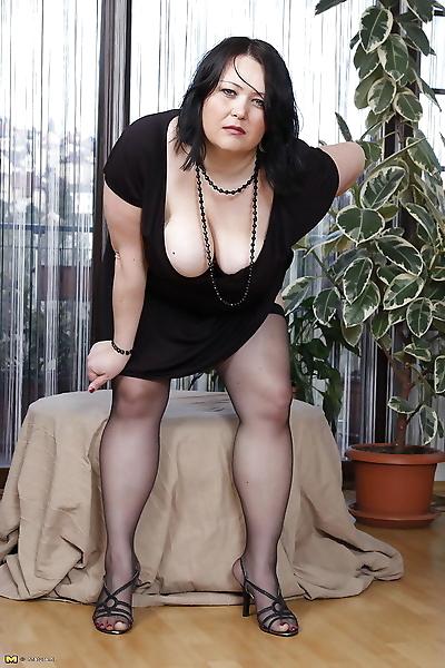 Big breasted mature slut..