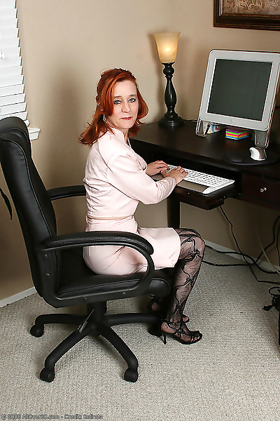 Redheaded office girl looks..