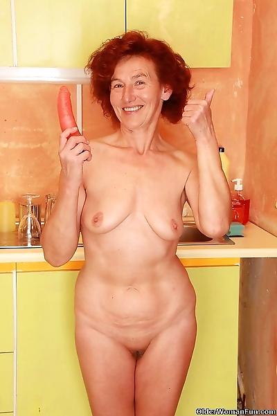 Granny hope fucks a dildo in..