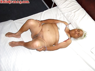 Granny in chair shows her..