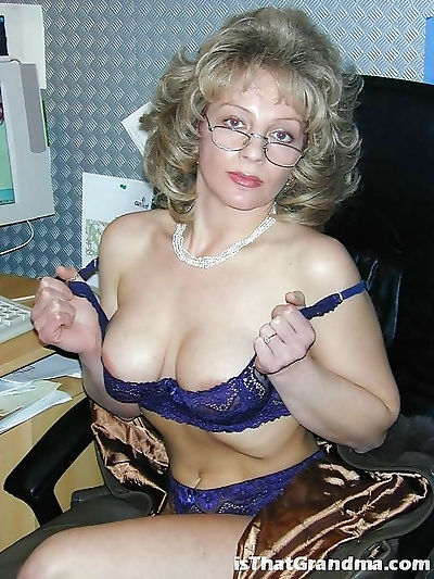 Grandma with glasses shows..