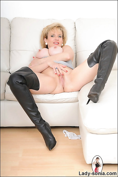 Leather thigh boots mature..