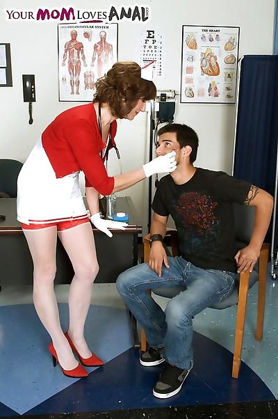 Mature nurse Elle Denay..