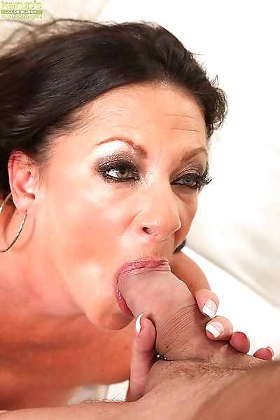 Big busted mom gives a..