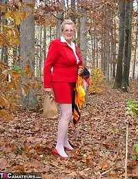 Horny granny Adonna removes her panties and toys herself in the woods