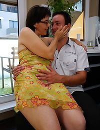 Older granny kissing and petting her toy boy and fucking in the kitchen