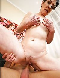 Naked granny and her boy toy warm up with foreplay before screwing
