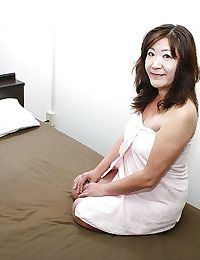 Saucy asian granny Michiko Okawa toying her hairy twat after shower