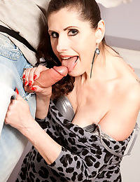 Horny mom Lorenzia entices a young handyman to give her some cock