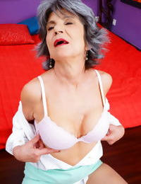 Naughty grandmother with great legs strips down to her bra and underwear