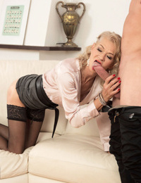 Hot granny Beata shows a younger guy a real good time in black stockings