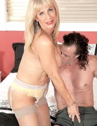 Blonde MILF Pheonix Skye wears stockings while shes enjoying a hard cock
