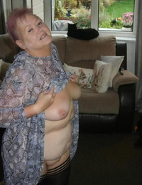 Fat nan Valgasmic Exposed casts off her dress to go naked in black stockings