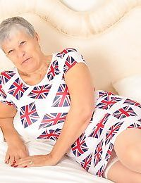 Old oma Savana hikes her dress up over lace panties and white bra