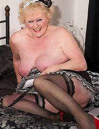 Old woman masturbates her horny cunt wearing a French maid outfit and heels