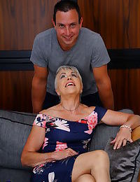 Horny grandmother with grey hair gets stripped to tan hosiery by toy boy